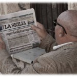 Sicilian man reading La Sicilia, copyright Jann Huizenga