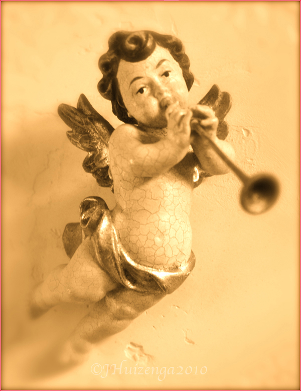 Winged wooden Sicilian cherub/angel/putto with trumpet, copyright Jann Huizenga