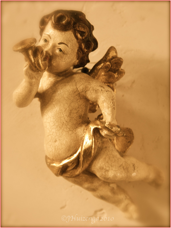 Winged Sicilian wooden cherub (putto) with horn, Copyright Jann Huizenga
