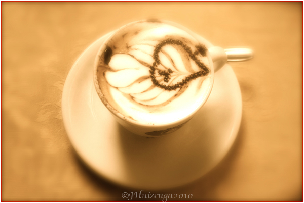 Cup of Cappuccino with Chocolate Heart on Foam, copyright Jann Huizenga