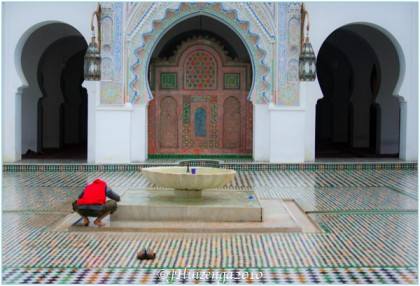 Man Praying in Fez Mosque, Morocco, copyright Jann Huizenga