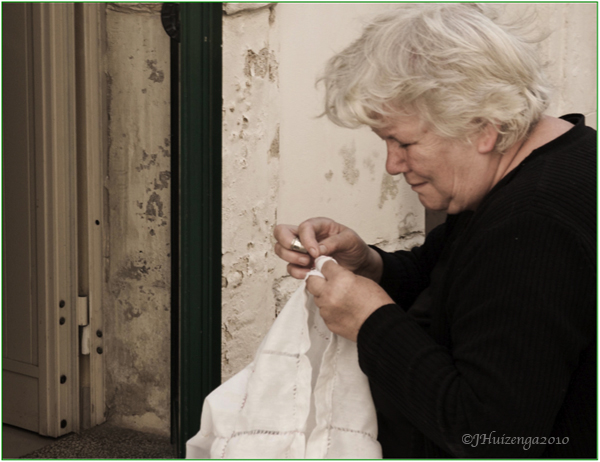 Sicilian Woman Working on Lace, copyright Jann Huizenga