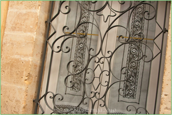 Lace at Sicilian Window, copyright Jann Huizenga