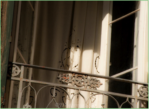 Sicilian Lace in Window, copyright Jann Huizenga