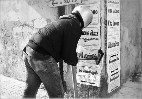 Putting Up Death Notices in Sicily, Copyright Jann Huizenga