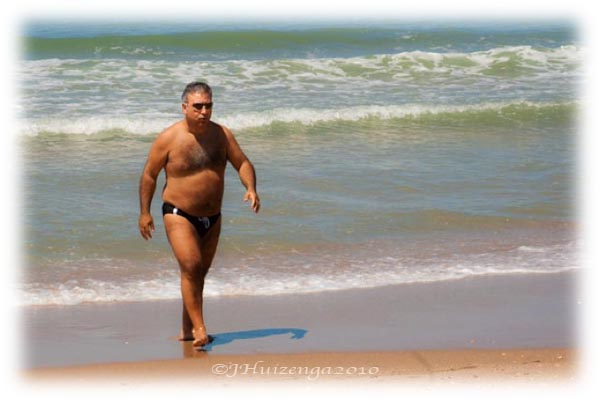 Sicilian in Speedo on Beach in Sicily, copyright Jann Huizenga