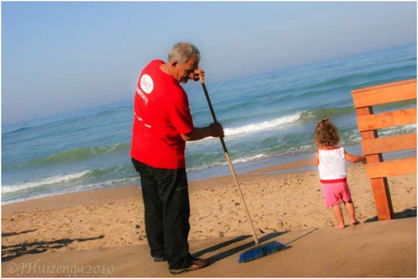 Sicilian Grandfather with Child on Beach in Sicily, copyright Jann Huizenga