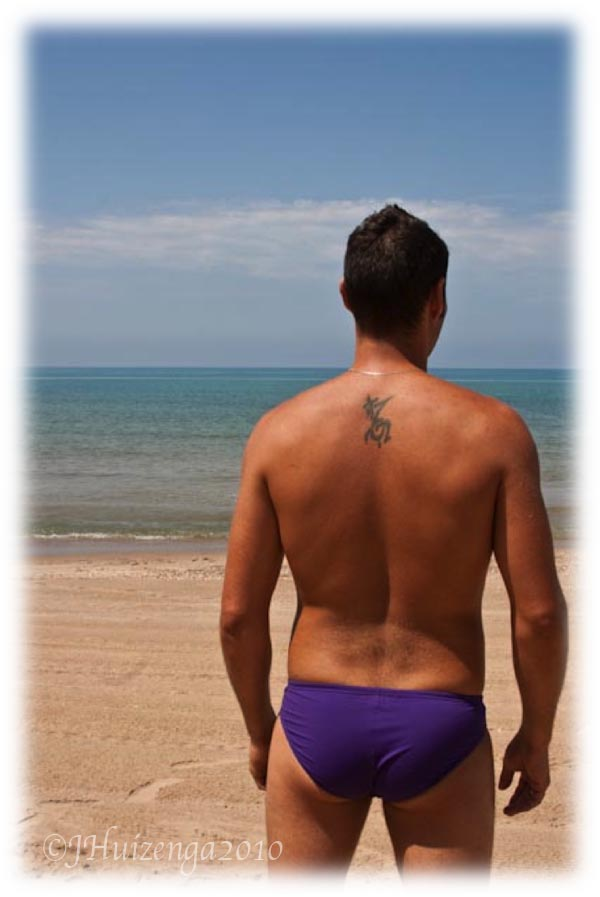 Sicilian in Speedo on Sicilian Beach, copyright Jann Huizenga