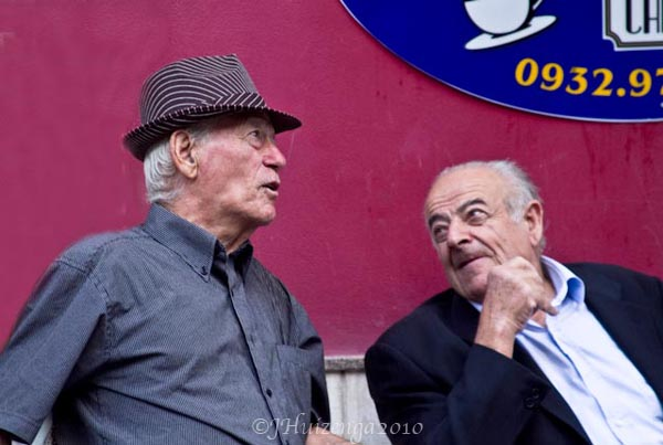 Two Sicilian Men Against Pink Wall, copyright Jann Huizenga