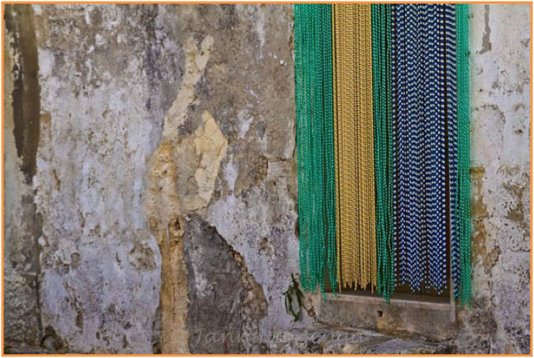 Plastic Beads to keep away flies in Sicily, copyright Jann Huizenga