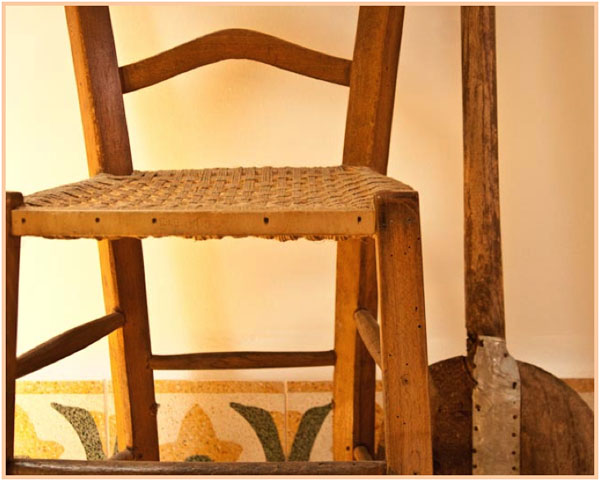Old Sicilian church chair with woven seat, copyright Jann Huizenga