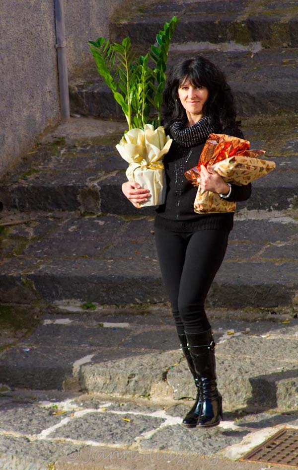 Sicilian Woman en route to Christmas Lunch, copyright Jann Huizenga