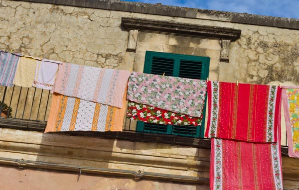 Christmas tablecloths hung out to dry in Sicily, copyright Jann Huizenga