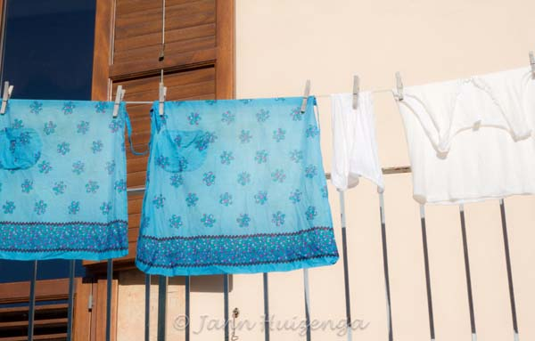 Aprons hanging on the line in Sicily, copyright Jann Huizenga
