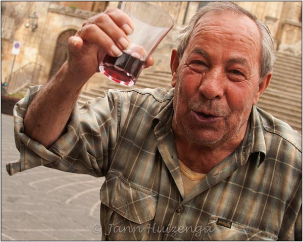Sicilian Man with Wine, copyright Jann Huizenga