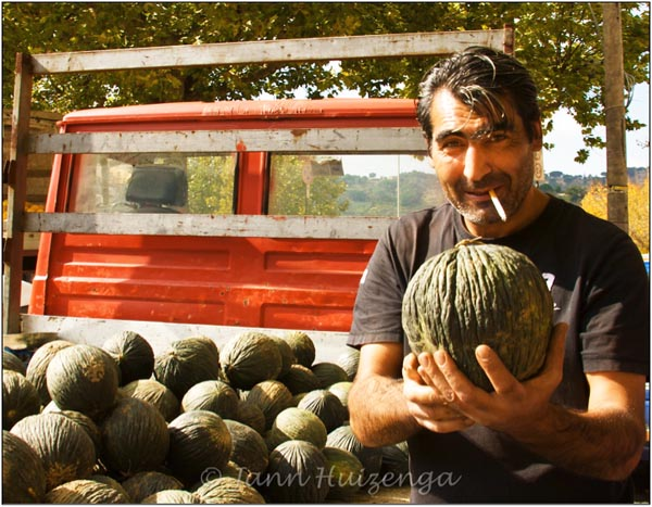 Sicilian Man with Melon, copyright Jann Huizenga