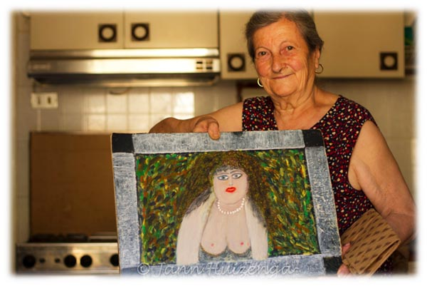 Sicilian Woman with Painting, copyright Jann Huizenga