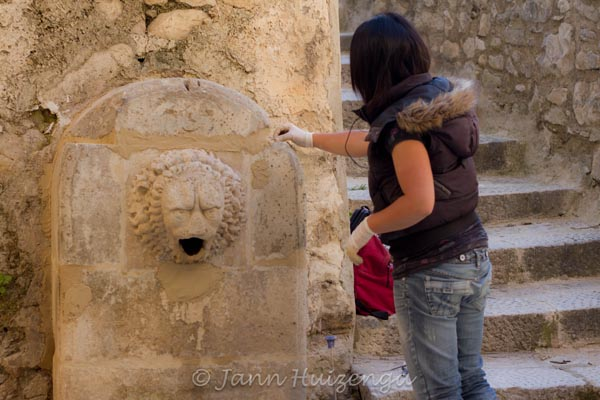 Restoring a Fountain in Ragusa Ibla, Sicily, copyright Jann Huizenga
