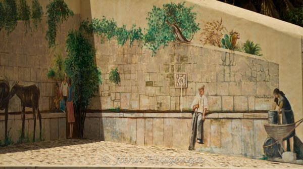 Mural on wall in Casaro, Sicily, Italy, copyright Jann Huizenga