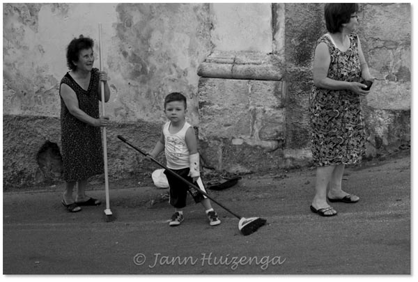 Sicilians Sweeping the Street, copyright Jann Huizenga