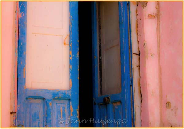 Open Blue Door in Pink Wall, copyright Jann Huizenga