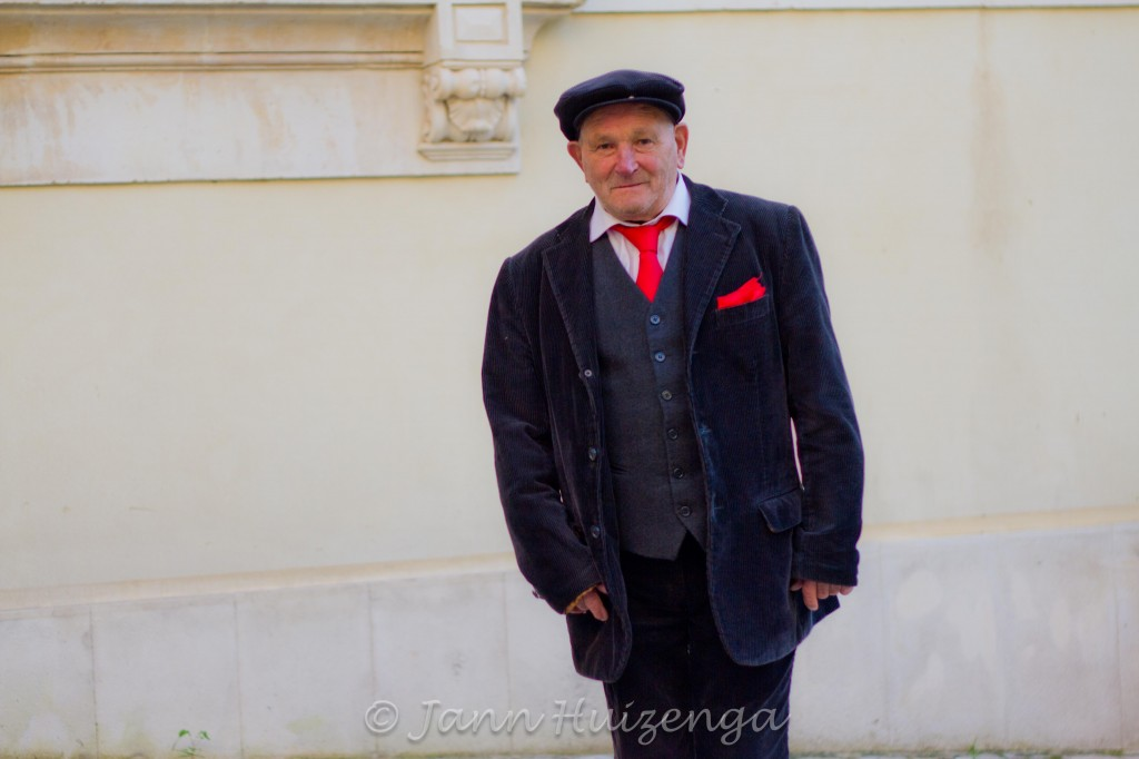 Sicilian Man in Red Tie, Scicli, Sicily, copyright Jann Huizenga