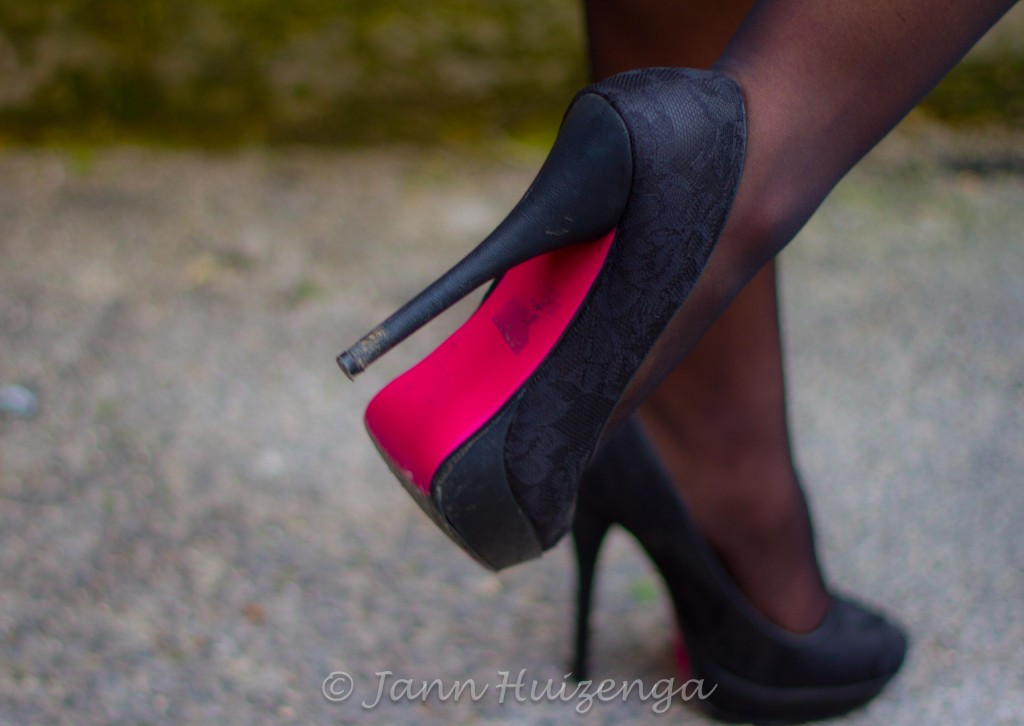 Women's Red-Soled Shoes in Sicily, copyright Jann Huizenga