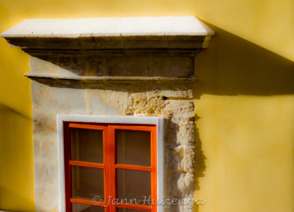 Orange Window on Yellow Wall in Southeast Sicily, copyright Jann Huizenga