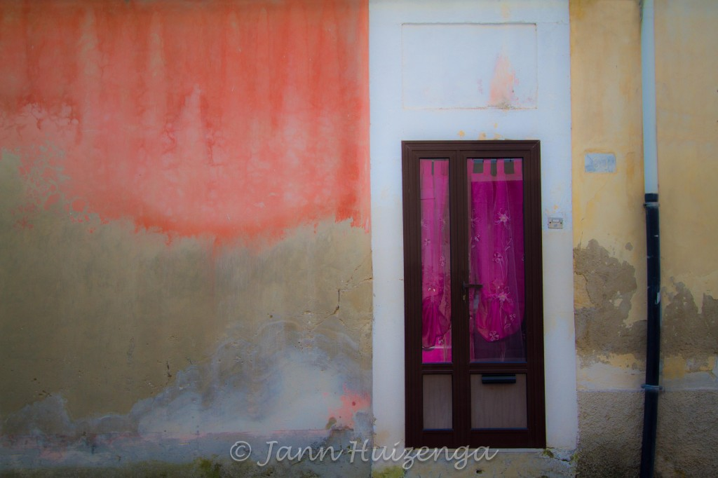 Pink Curtain in Sicilian Door and Orange Flame Wall in Southeast Sicily, copyright Jann Huizenga