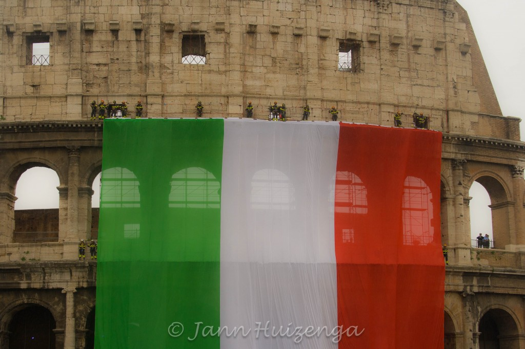 Italian Flag on Roman Colosseum, copyright Jann Huizenga