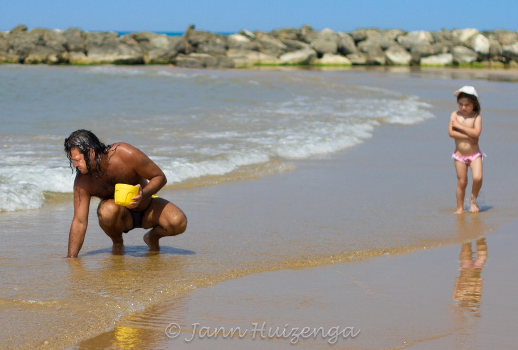 Sicilian Man Digging for Clams in Beach, copyright Jann  Huizenga