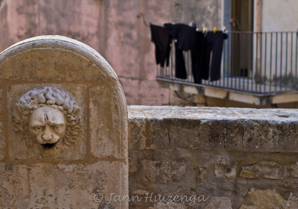 Stone lion fountain in Ragusa Ibla, copyright Jann Huizenga