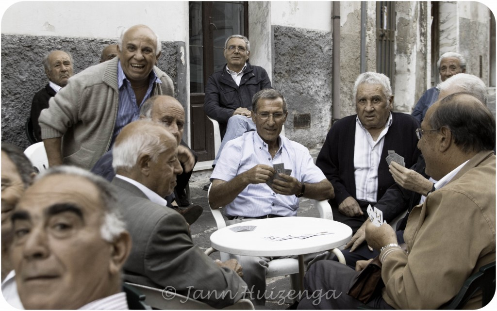 Sicilian Men Playing Cards Outside, copyright Jann Huizenga