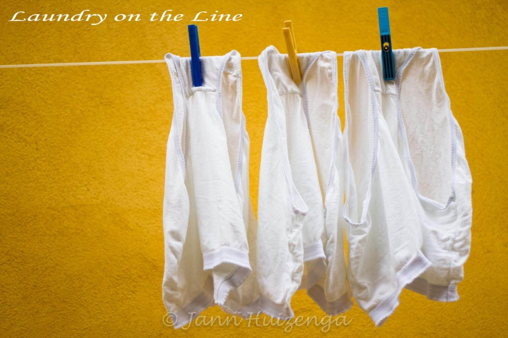 Laundry on the line in Sicily, copyright Jann Huizenga