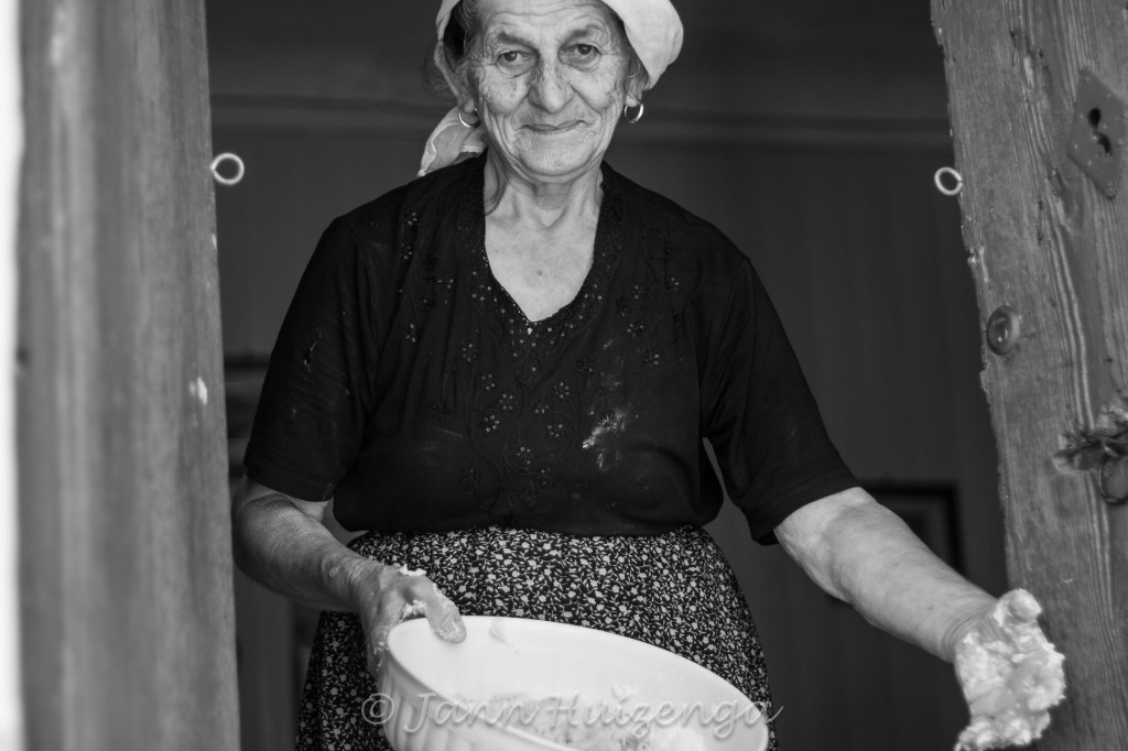 Sicilian Woman Making Bread, copyright Jann Huizenga