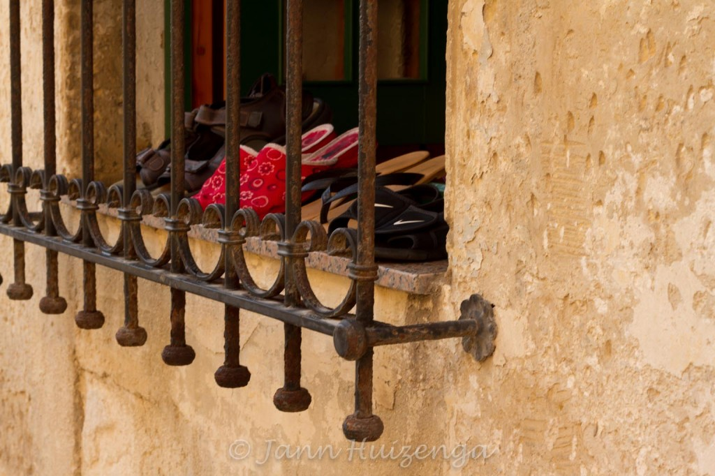Airing out shoes, Sicily, copyright Jann Huizenga