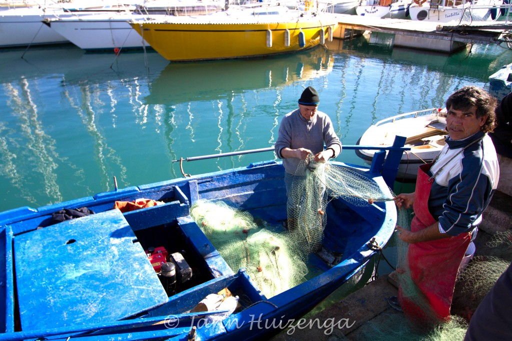 Fishermen in Palermo Harbor, copyright Jann Huizenga