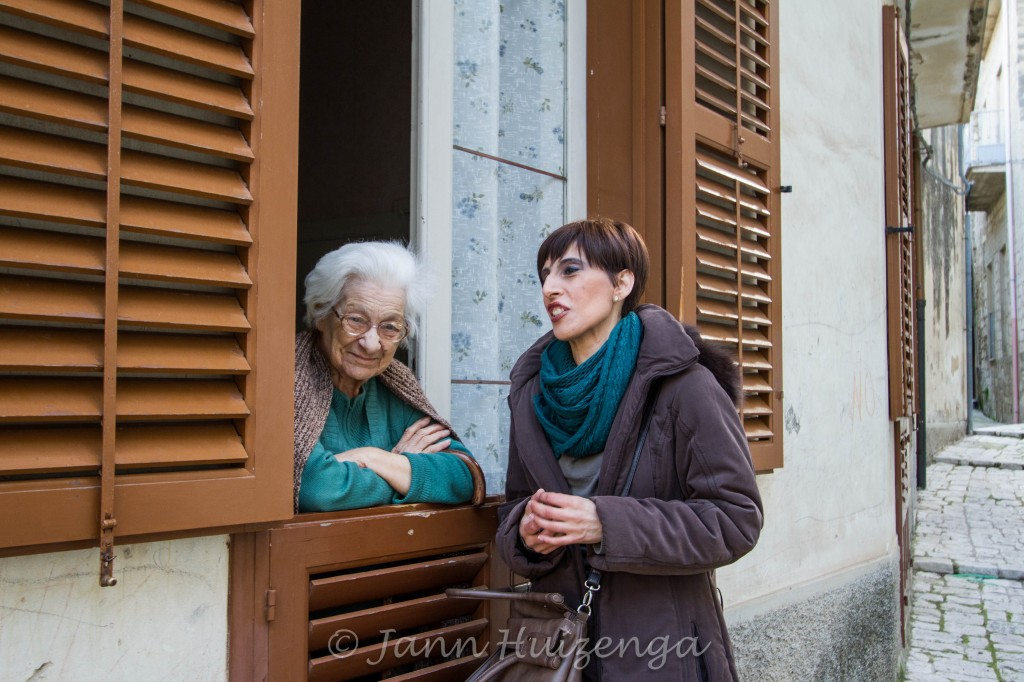 Sicilian Women Chatting at Window, copyright Jann Huizenga