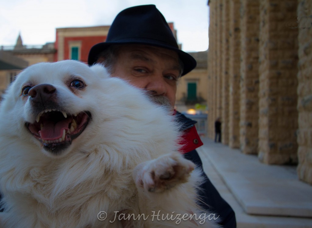 Sicilian Man with Dog, copyright Jann Huizenga