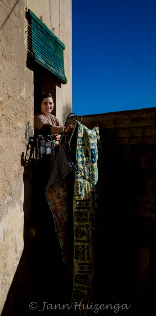 Airing out quilts in Sicily, copyright Jann Huizenga