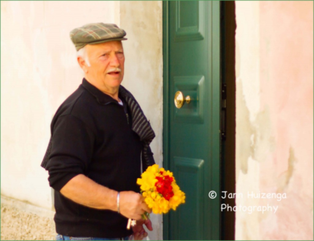 Sicilian Man with FLowers, copyright Jann Huizenga