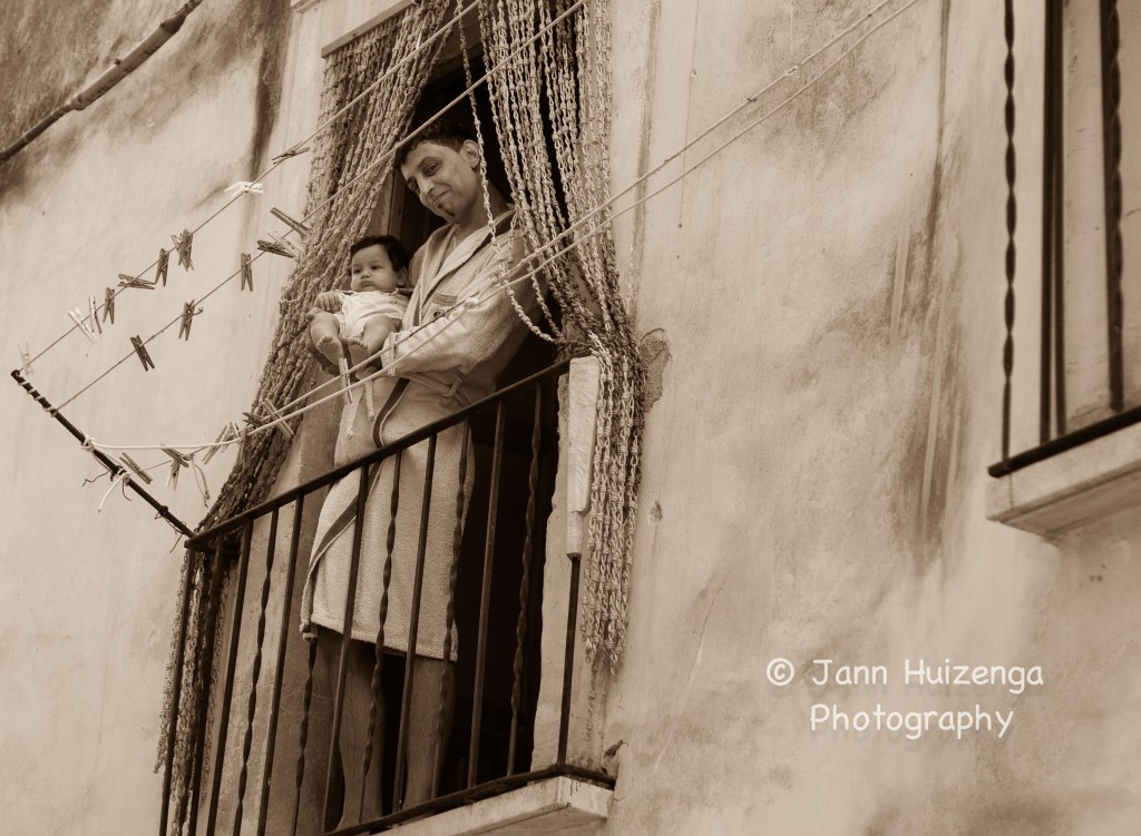Sicilian Father on Balcony, copyright Jann Huizenga