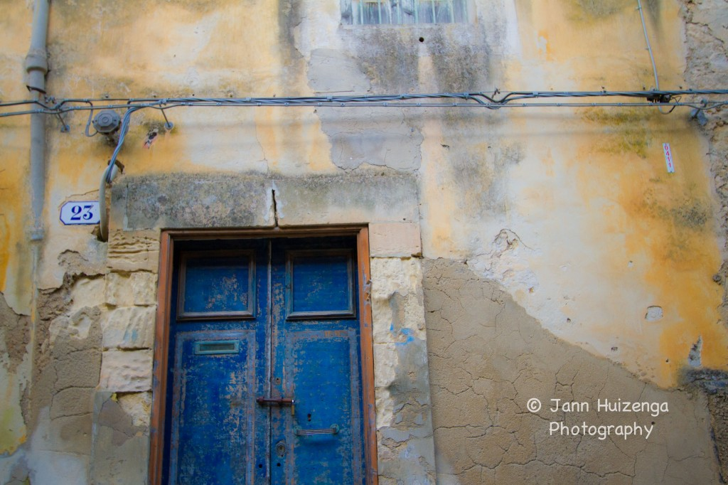 Tin-clad door in Sicily, copyright Jann Huizenga
