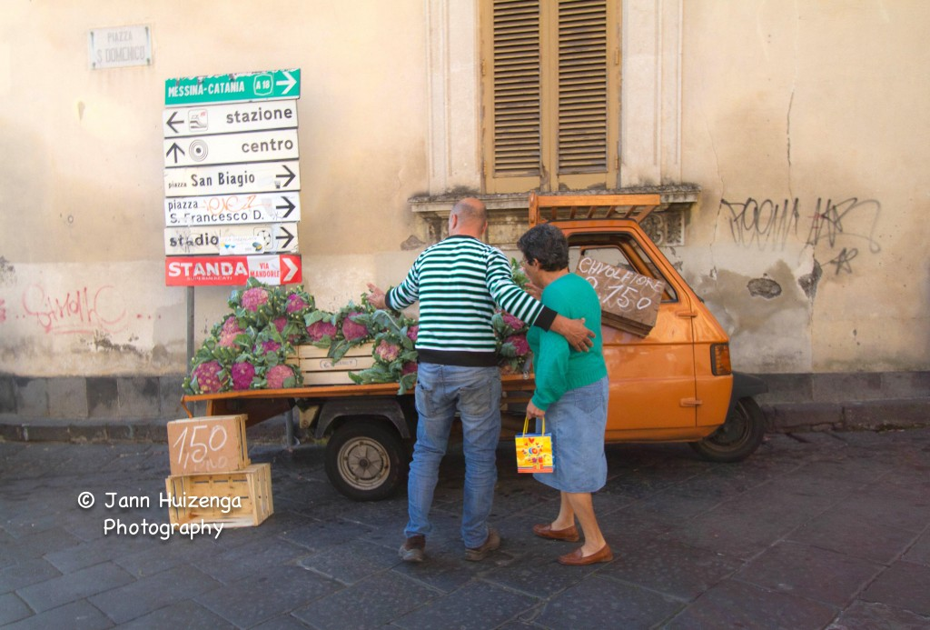 Man Selling Pink Cauliflower in Sicily, copyright Jann Huizenga