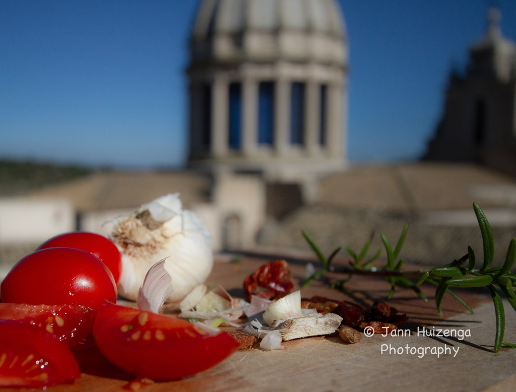 Cooking Near the Cathedral at Ragusa Ibla, copyright Jann Huizenga