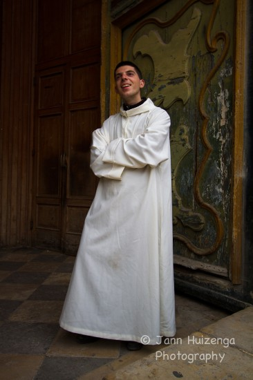 Young Sicilian Priest, copyright Jann Huizenga