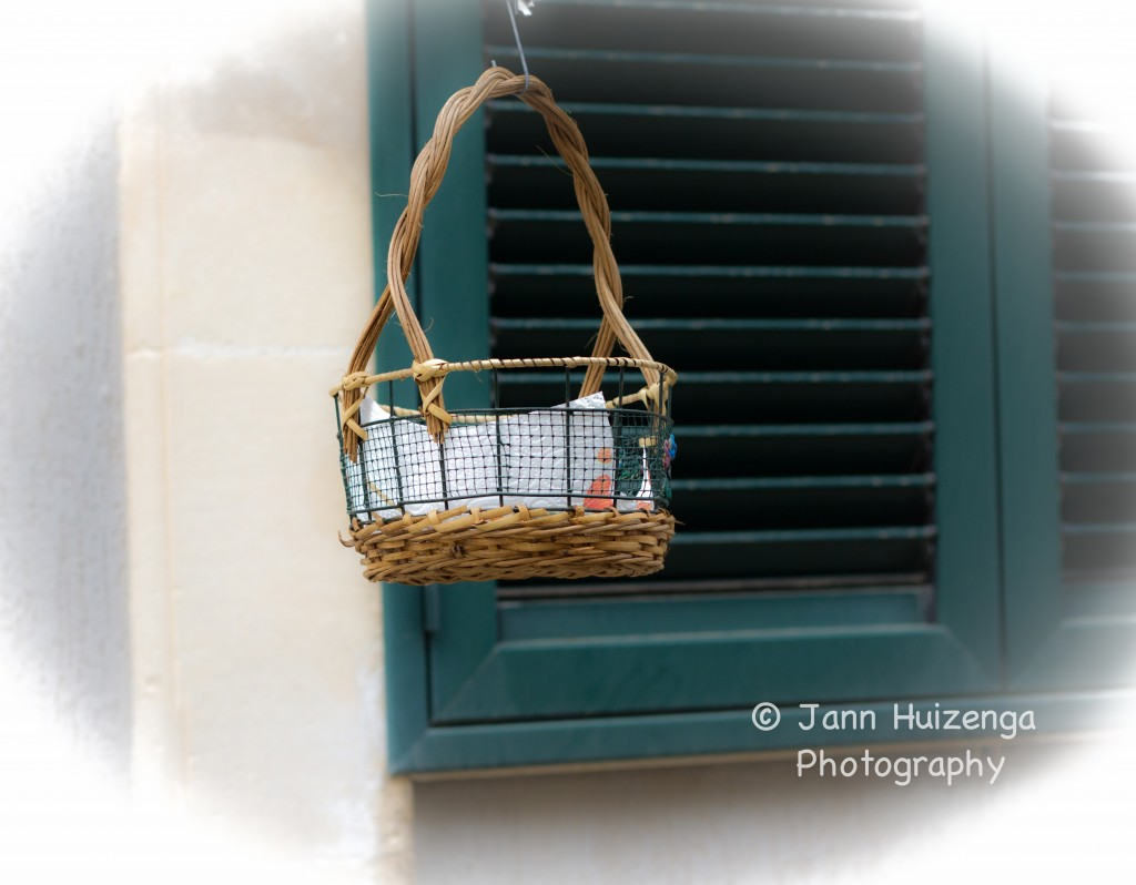 Lowered Basket for Bread in Sicily, copyright Jann Huizenga