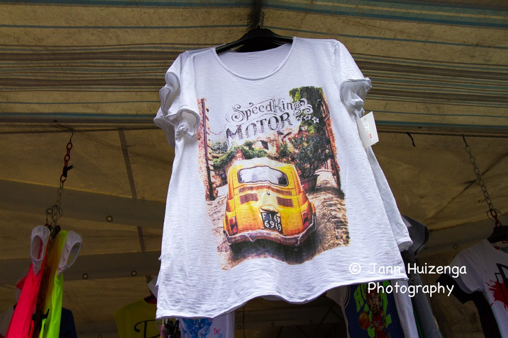 Italian T-shirt at market, copyright Jann Huizenga